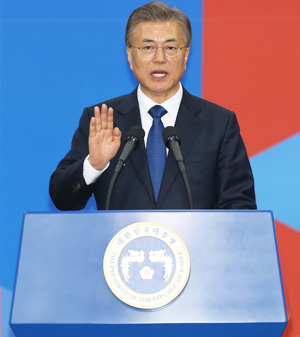 Moon Jae-in is sworn in as South Korea's 19th president during an inauguration ceremony at the National Assembly's Rotunda Hall on Wednesday. / Yonhap