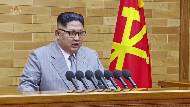 North Korean leader Kim Jong-un delivers a New Year's message broadcast by the state-run TV station, Monday. / Yonhap