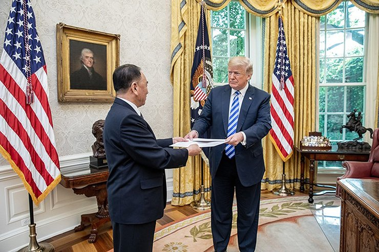 President Donald J. Trump is presented with a letter from North Korean leader Kim Jong Un, on June 1, 2018, by North Korean envoy Kim Yong Chol in the Oval Office at the White House in Washington, DC. White House Photo by Shealah Craighead