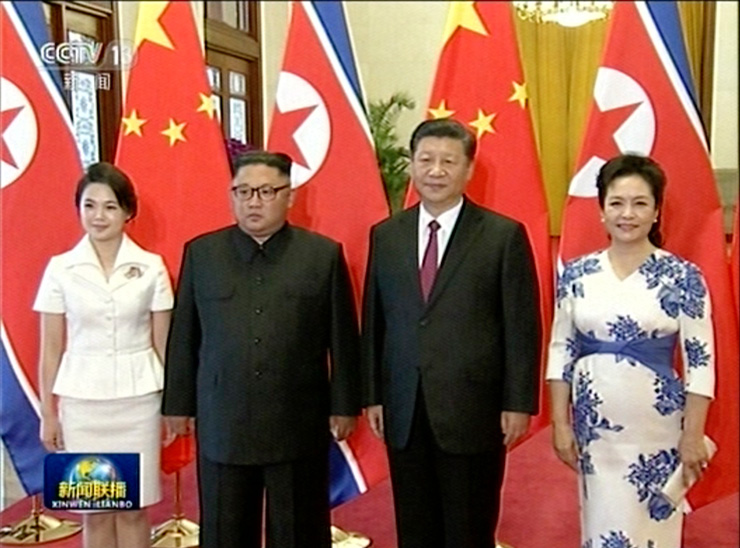 In this image taken from video footage run by China's CCTV on June 19, 2018, via AP Video, Chinese President Xi Jinping shakes hands with North Korean leader Kim Jong Un during a welcome ceremony at the Great Hall of the People in Beijing. / AP