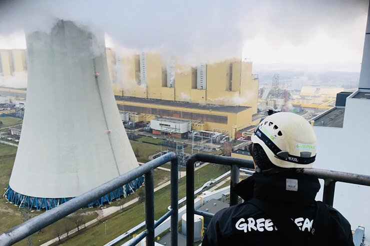 Handout photo taken and released on November 27, 2018 by environmental organization Greenpeace, shows a Greenpeace activist after he climbed a 180 metre-high chimney at Poland's Belchatow coal-fired power plant Belchatow. AFP via Greenpeace
