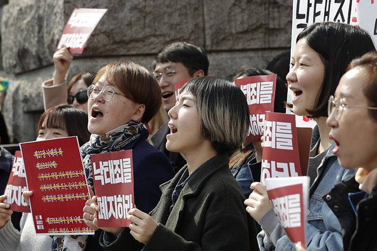 Pro-life demonstrators hold banners near a police officer during a rally supporting South Korea's anti-abortion regulations outside of the Constitutional Court in Seoul, South Korea, Thursday, April 11, 2019. Korea Times photo by Shim Hyun-chul