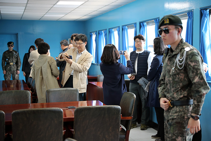 North Korean soldiers look at the South side, seen during a press tour at the border village of Panmunjom in the Demilitarized Zone, South Korea, Wednesday, May 1, 2019. Joint Press Corps