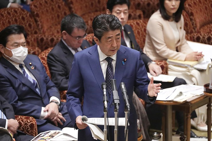 Japanese Prime Minister Shinzo Abe addresses Parliament in Tokyo on March 23, 2020. A decision to postpone the 2020 Olympics 'may become inevitable' if the new coronavirus outbreak makes it impossible to hold the Games safely, Japan's prime minister said on March 23. (Photo by - / JIJI PRESS / AFP)