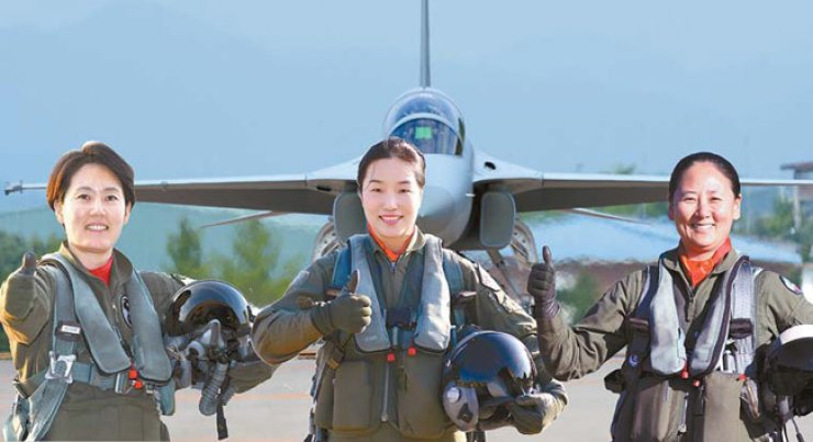 This photo provided by the Air Force shows Maj. Park Ji-won, from left, Maj. Park Ji-yeon and Maj. Ha Jung-mi, three pilots who have been recently appointed as the country's first female vice commanders of fighter squadrons. / Yonhap