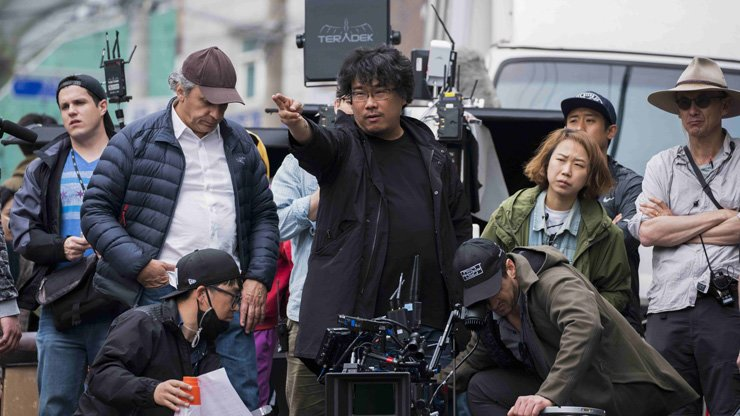Director Bong Joon-ho, center, is seen during the filming of 'Okja,' set for release on Netflix, June 29. Courtesy of Netflix