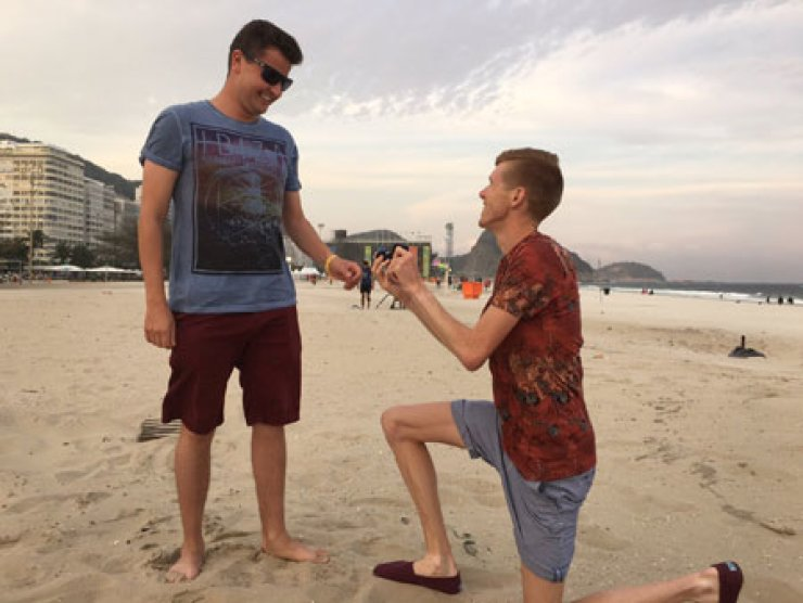 U.K. race walker Tom Bosworth proposes to his boyfriend Harry Dineley at Copacabana beach in Rio de Janeiro, Wednesday. / Courtesy of Tom Bosworth's Twitter