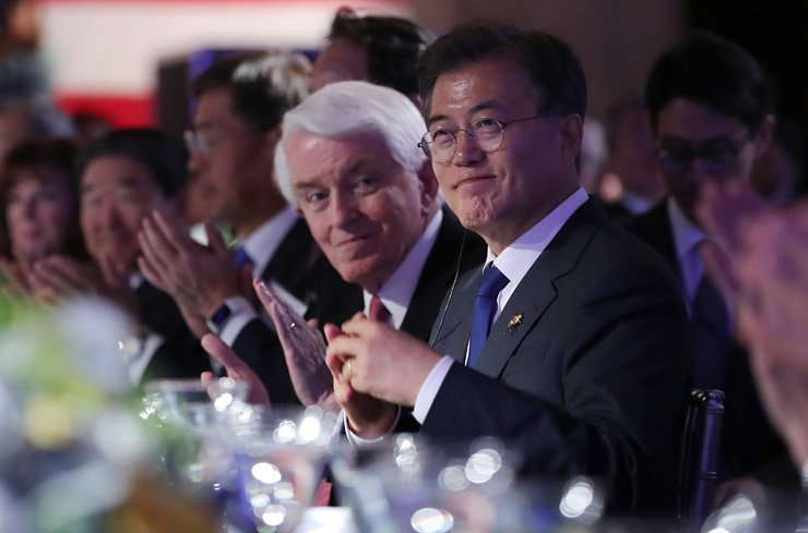 President Moon Jae-in listens to a speech during a business summit organized by Korea and the U.S.' chambers of commerce at the International Hall of Flags in Washington, D.C., Wednesday. / Yonhap