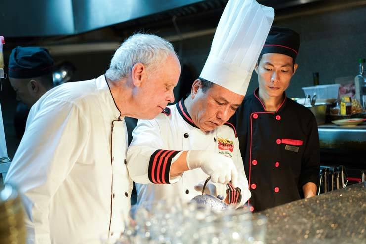 From left, British Michelin-starred chef John Burton-Race and 2012 Iron Chef Vietnam winner Nguyen Thanh Tung prepares special dinner at HOME Finest Saigon restaurant in Ho Chi Minh City, Vietnam, in last May. / Courtesy of Paradise Vietnam