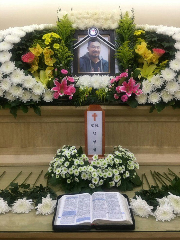 A portrait of Phillip Clay, a deported Korean-American adoptee, is displayed at his funeral, Tuesday, in Myongji Hospital, Goyang, Gyeonggi Province. He allegedly committed suicide, Sunday. / Courtesy of Simone Eun Mi