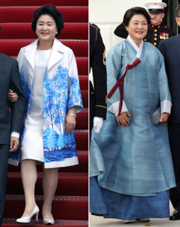 In the left photo, first lady Kim Jung-sook wears a jacket with a pattern of trees in blue, when she and President Moon Jae-in arrives in Washington, D.C., for a summit, Wednesday. In the right photo, she wears an indigo blue hanbok. / Yohap