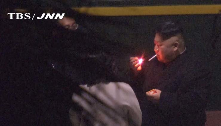 In this image made from Japan's TBS TV video on early Tuesday, North Korean leader Kim Jong-un, a habitual smoker, takes a pre-dawn smoke break at the train station in Nanning, China, hours before his arrival in Vietnam for his high-stakes summit with President Donald Trump over resolving the international standoff over the North's nuclear weapons and missiles. TBS/JNN-AP-Yonhap