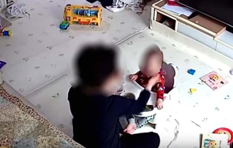 Babysitter from the goverment's childcare center forces baby to eat food in this surveilance camera footage uploaded by the parents online. / Yonhap