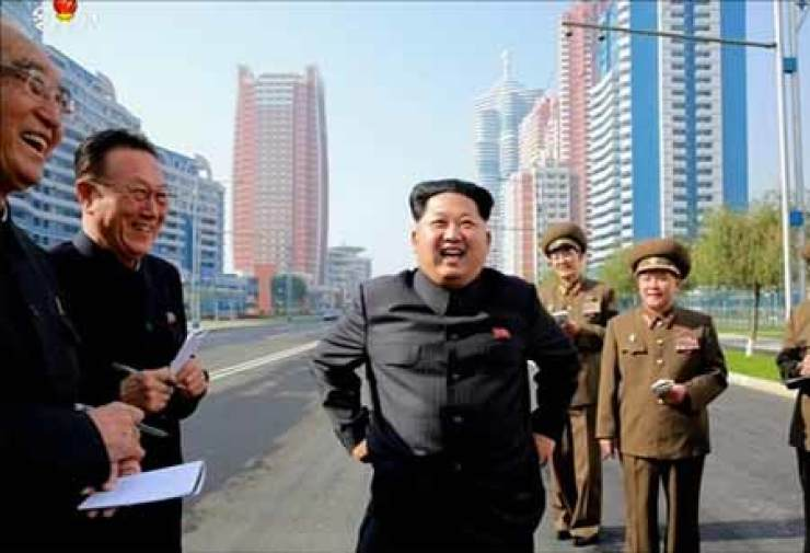 North Korean leader Kim Jong-un smiles while reviewing a new street hosting a residential complext for scientists in Pyongyang in this Oct. 21 photo. / Yonhap