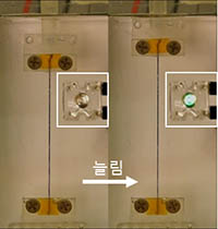Kim Seon-jeong, professor at Hanyang UniversitySeen is a test of the 'twistron yarn' producing electric power to turn on a small light bulb as it is stretched. / Courtesy of Ministry of Science and ICT