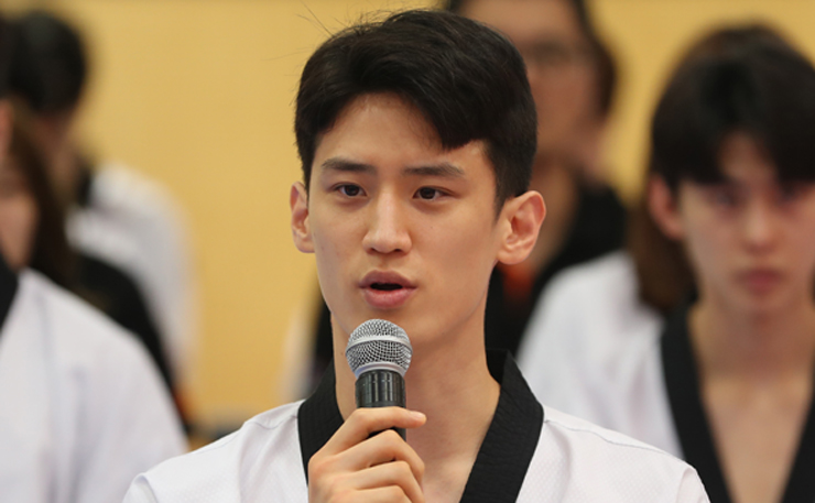 National taekwondo team athletes practice poomsae, an attack and defense pattern in the sport, during the Media Day event at the National Training Center in Jincheon, North Chungcheong Province on Aug. 8. Yonhap