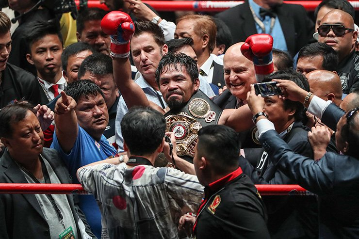 Filipino senator and boxing icon Manny Pacquiao celebrates after defeating Argentina's Lucas Matthysse during their WBA welterweight championship fight in Kuala Lumpur, Malaysia, Sunday. EPA