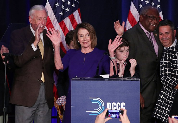 U.S. House Minority Leader Nancy Pelosi celebrates the Democrats winning a majority in the U.S. House of Representatives with House Minority Whip Steny Hoyer (L), her grandson Paul (3rd R), U.S. Rep. James Clyburn (2nd R) and Democratic Congressional Campaign Committee (DCCC) Chairman Ben Ray Lujan (R) during a Democratic midterm election night party in Washington, U.S. Nov. 6. Reuters