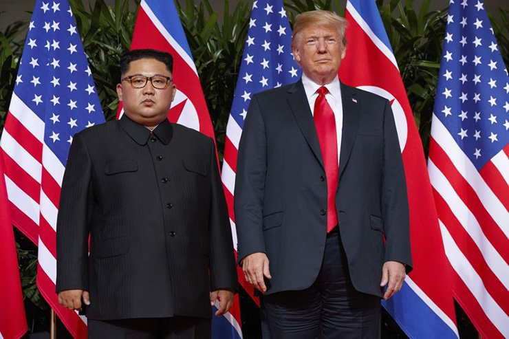In this June. 12, 2018, file photo, U.S. President Donald Trump, right, meets with North Korean leader Kim Jong-un on Sentosa Island, in Singapore. North Korea has warned on Friday it could revive a state policy aimed at strengthening its nuclear arsenal if the United States does not lift economic sanctions against the country. AP