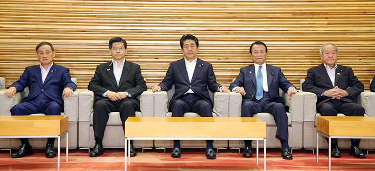 Japan's Prime Minister Shinzo Abe, center, and other ministers attend a cabinet meeting at Prime Minister's Office in Tokyo, Japan, Aug. 2. Japan decided to remove Korea from the 'white list' of countries that benefit from simplified trade procedures. The measure will take effect on Aug. 28. EPA