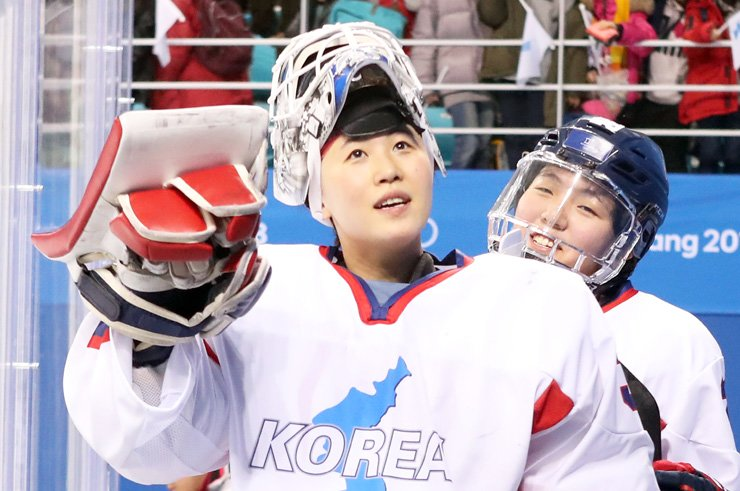 The joint Korean women's ice hockey team's Shin So-jung, left, and Lee Jin-gyu react after losing to Switzerland 2-0 in the classification match of the PyeongChang Olympics at Kwandong Hockey Centre on Sunday. / Yonhap