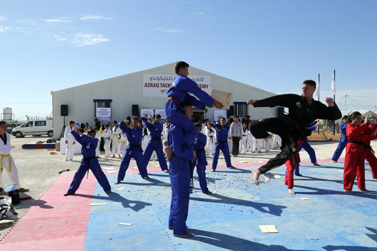 Children at the Azraq Taekwondo Academy in the Azraq refugee camp in Jordan perform taekwondo during the opening ceremony for the academy, April 1. / Courtesy of World Taekwondo