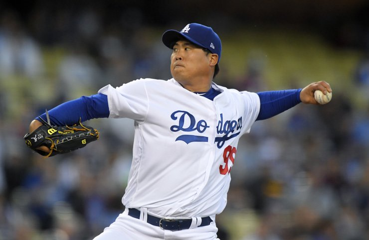 Los Angeles Dodgers starting pitcher Ryu Hyun-jin throws to the plate during the first inning of the team's baseball game against the Colorado Rockies in Los Angeles, Tuesday. / AP-Yonhap