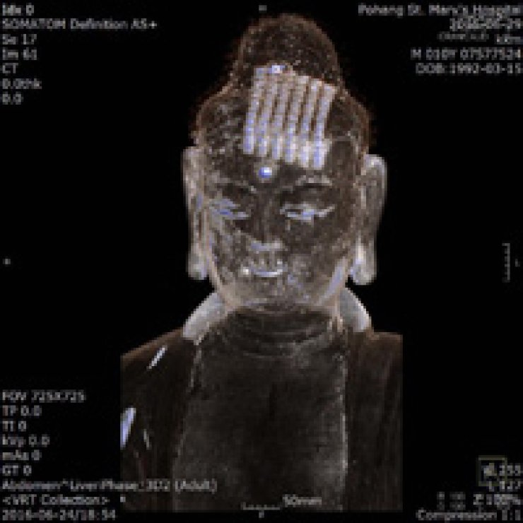 A scripture is shown inside the head of the Buddha statue from Silsangsa Temple in this CT image. / Yonhap