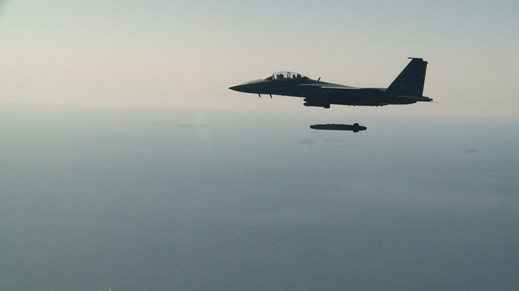 In the top photo, a Republic of Korea Air Force F-15K fighter jet fires a Taurus long-range air-to-surface missile over the West Sea during a live-fire exercise, Tuesday. In the middle photo, the missile flies toward a designated target using its independent navigation system, and hits a target precisely in the bottom photo. / Courtesy of Air Force