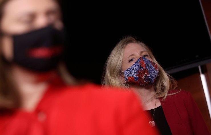 U.S. Rep. Abigail Spanberger looks on from behind Rep. Elissa Slotkin as House Democrats respond to a White House briefing on reports Russia paid the Taliban bounties to kill U.S. troops during a news conference following the briefing at the U.S. Capitol in Washington, U.S., June 30. / REUTERS-Yonhap