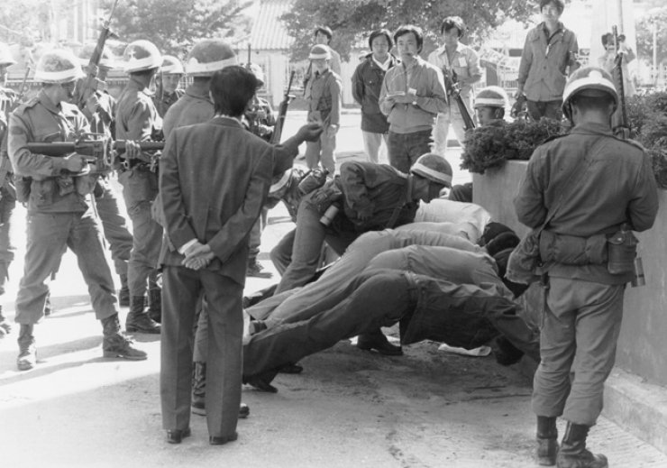 Martial law forces subdue protesters in the Gwangju Uprising on May 18, 1980. / Korea Times file