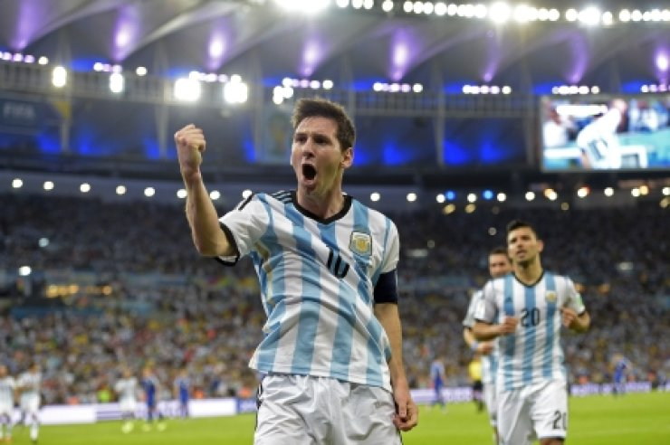 Argentina's forward and captain Lionel Messi celebrates scoring during a Group F match between Argentina and Bosnia-Herzegovina at the Maracana Stadium in Rio De Janeiro. / AFP-Yonhap