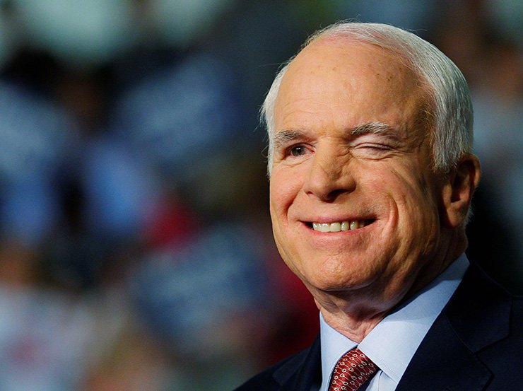 U.S. Republican presidential nominee Senator John McCain (R-AZ) winks at an audience member at a campaign rally in Dayton, Ohio October 27, 2008. Reuters
