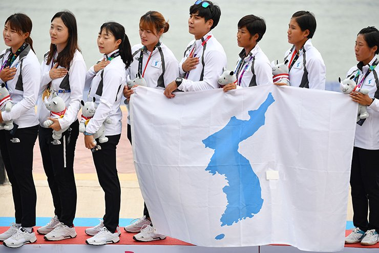 Unified Korea's gold medallists sing the national folk song 'Arirang' during the awards ceremony for the women's canoe traditional 500m boat race at the 2018 Asian Games in Palembang, Sunday. AFP