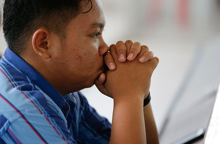 A Christian prays inside a church at the earthquake and tsunami-hit town of Palu, Central Sulawesi, Indonesia Sunday, Oct. 7, 2018. Christians dressed in their tidiest clothes flocked to Sunday sermons in the earthquake and tsunami damaged Indonesian city of Palu, hoping for answers to the double tragedy that inflicted deep trauma on their community. AP