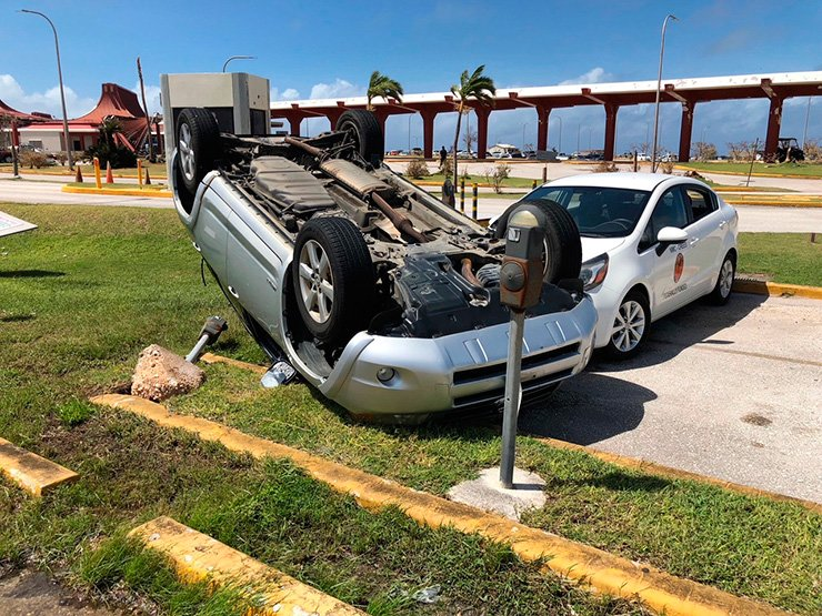 An overturned car is shown at the airport after Super Typhoon Yutu hit the U.S. Commonwealth of the Northern Mariana Islands, Friday, Oct. 26, 2018, in Garapan, Saipan. Residents of the U.S. territory are preparing for months without electricity or running water after the islands were slammed with the strongest storm on Thursday to hit any part of the U.S. this year. AP
