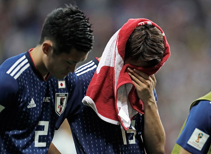 Japan's disappointed Hiroki Sakai covers his face after losing the round of 16 match between Belgium and Japan at the 2018 World Cup in the Rostov Arena, in Rostov-on-Don, Russia, Monday. AP