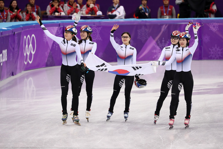 Korea's female speed skaters scream in joy after winning a gold medal in the 3000-meter short track relay at the Gangneung Ice Arena, Tuesday. / Korea Times photo by Shim Hyun-chul