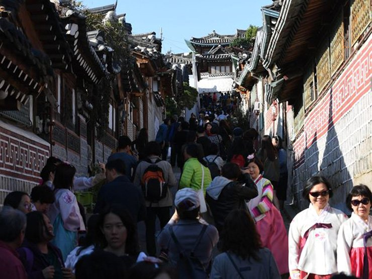 Bukchon Hanok Village is crowded with tourists. Korea Times