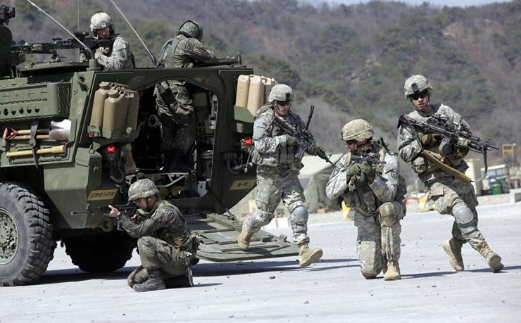 U.S. Army and South Korean soldiers take positions during the annual Foal Eagle joint military exercise at the Rodriquez Multi-Purpose Range Complex in Pocheon, Gyeonggi Province, in March 2015. AP