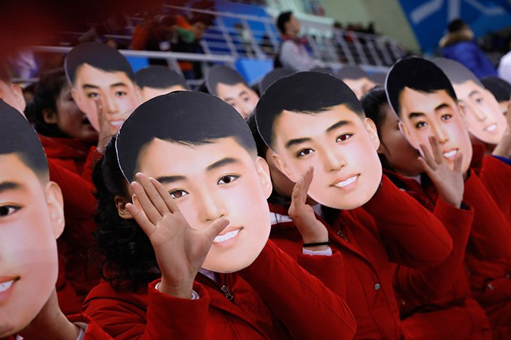 North Korean cheerleaders wear masks of a man's face during the North-South joint women's hockey team game at Kwandong Hockey Centre in Gangneung, Saturday. The masks drew controversy as the face resembles North Korean founder Kim Il-sung in his youth. However, the Unification Ministry explained the masks featured the face of a North Korean actor. / Korea Times photo by Shim Hyun-chul