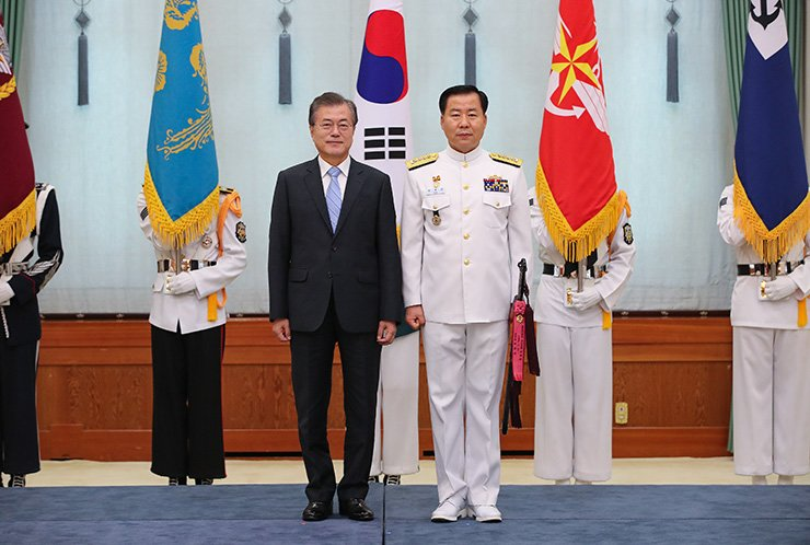 Adm. Sim Seung-seob, left, and President Moon Jae-in / Yonhap