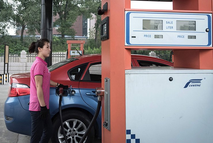 In this file photo taken on July 21, 2017, a petrol pump attendant fills up a taxi with gasoline at a fuel station in Pyongyang. Russia and China on July 19, 2018, asked for more time to consider a request from the U.S. to the UN Security Council to halt all deliveries of refined oil products to North Korea, U.S. diplomats said. The U.S. asked a UN sanctions committee last week to ban further shipments after accusing North Korea of exceeding a UN cap on the fuel deliveries through illegal imports. AFP