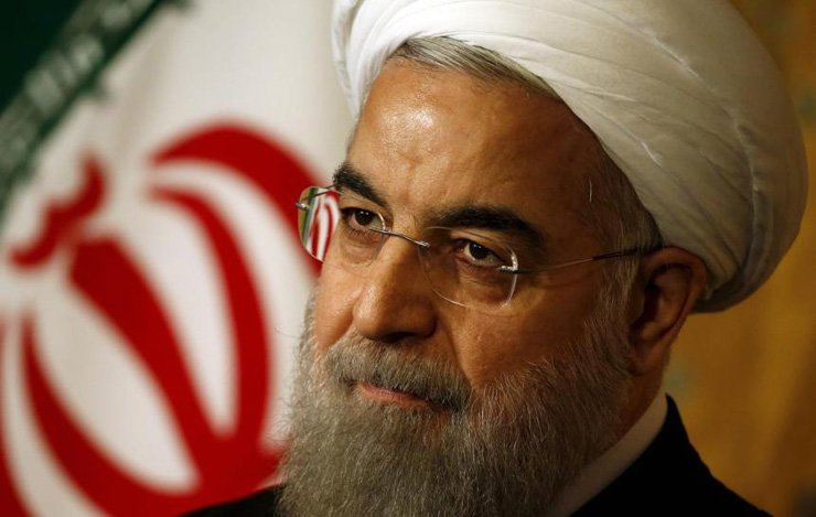President Hassan Rouhani warned Tuesday that Iran could restart enriching uranium 'without any limitations'' within weeks, after President Donald Trump pulled America out of the nuclear deal. / Reuters
