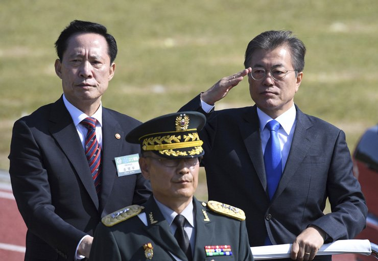President Moon Jae-in and Defense Minister Song Young-moo review troops during a ceremony marking the 69th anniversary of Armed Forces Day at the Navy's 2nd Fleet Command in Pyeongtaek, Gyeonggi Province, Thursday. / Joint Press Corps