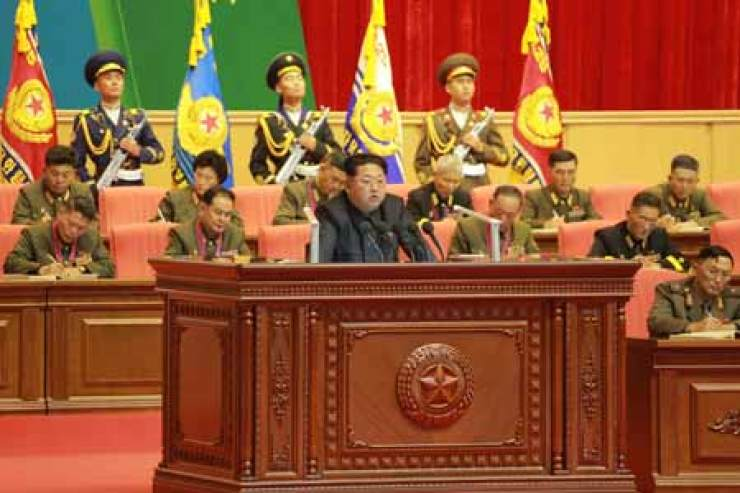 North Korean  leader Kim Jong-un, on podium, stresses Thursday the importance of political thought in a meeting of military workers in Pyongyang, North Korea. / Yonhap