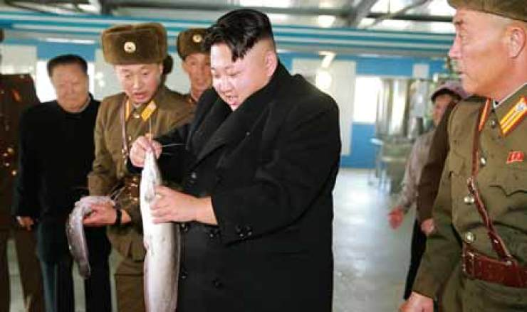 North Korean leader Kim Jong-un inspects a catfish farm, the Korean Central News Agency reported on Dec. 12. / Yonhap