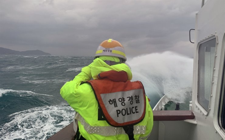 Maritime police search the missing crew members in waters off the southern island of Geoje, Saturday. /Courtesy of Coast Guard