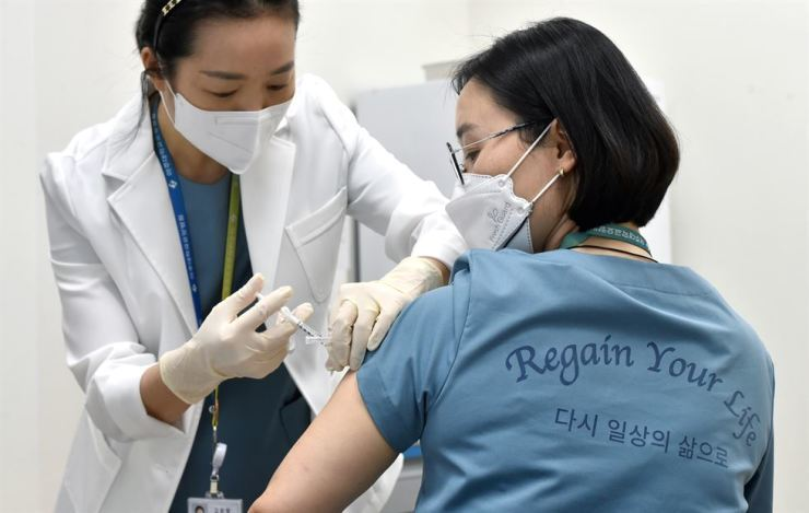 A woman receives a coronavirus vaccine from AstraZeneca in a nursing home in Suwon, Gyeonggi Province. Friday. Yonhap