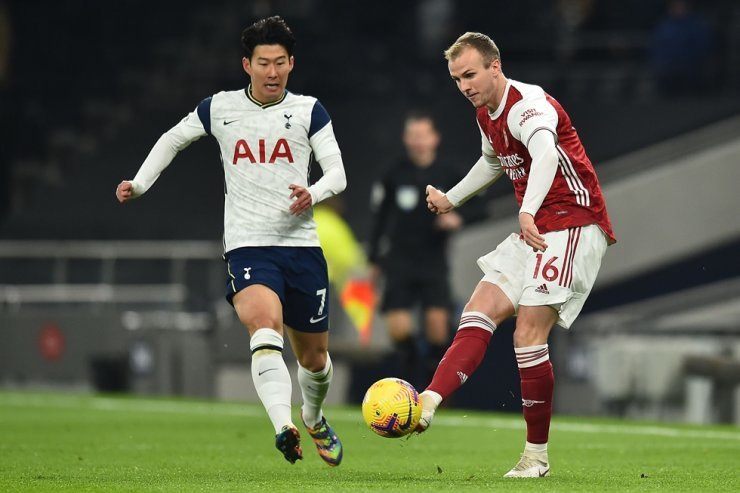 Tottenham Hotspur's striker Son Heung-min, left, vies with Arsenal defender Rob Holding during their English Premier League football match at Tottenham Hotspur Stadium in London, Dec. 6. AFP